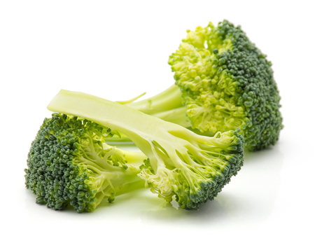 Fresh broccoli isolated on white background one tree like and two slices