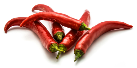 Five red Chili peppers tisolated on white background  Stock Photo
