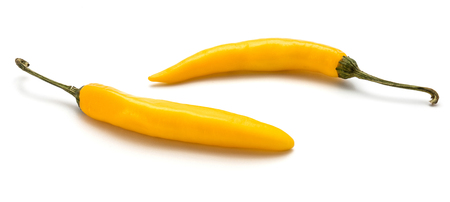 Pair of yellow Chili peppers isolated on white background