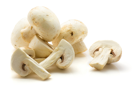 Champignons isolated on white background heap of whole and sliced