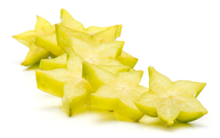 Sliced carambola star slices isolated on white background heap