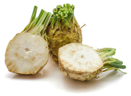 One whole and two halves of fresh celery root isolated on white background cross section