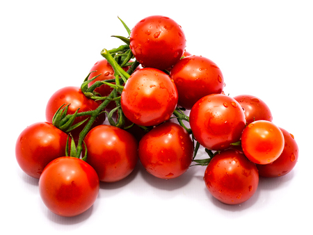 Whole red tomato cherry isolated on white background