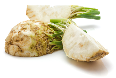 Two quarters of fresh celery root and one half isolated on white background  Stock Photo