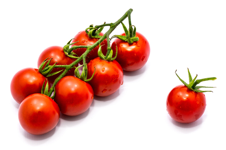 Group of whole red tomato cherry isolated on white background