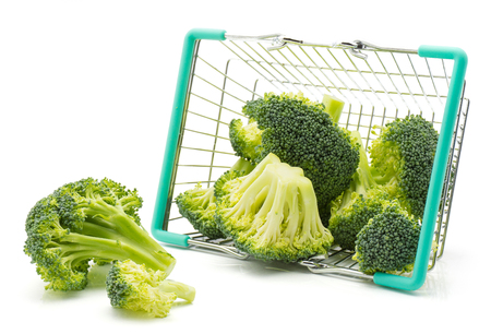 Fresh broccoli scattered out a shopping basket isolated on white background  Stock Photo