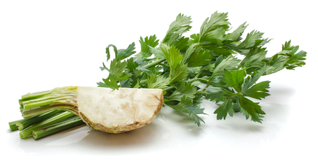 One quarter of celeriac and fresh celery bunch isolated on white background