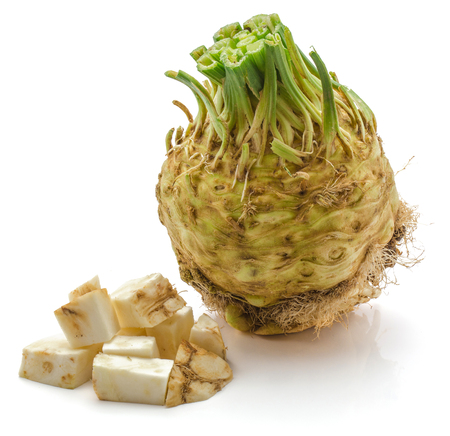 One whole bulb of celery root and sliced pieces isolated on white background