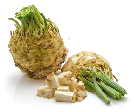 One whole bulb of fresh celery root, one half and chopped pieces, isolated on white background  Stock Photo