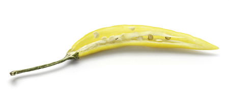 Yellow Chili pepper, one half, isolated on white background  Stock Photo