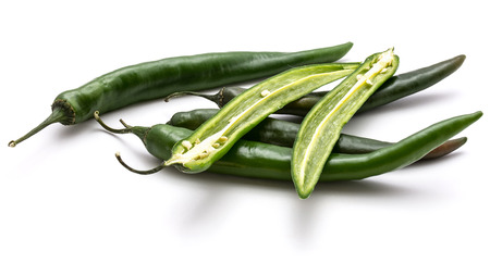 Group of green Chili peppers, whole and two halves, isolated on white background  Stock Photo