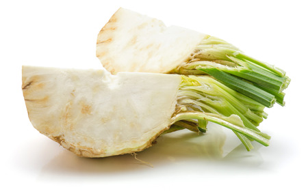 Two quarters of fresh celery root isolated on white background