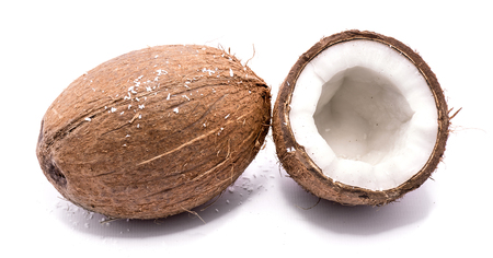 One whole coconut with shavings and one half isolated on white background