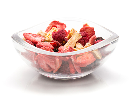 Freeze dried berries mix in a glass bowl isolated on white background