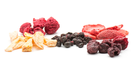 Freeze dried berries mix isolated on white background comparing stacks