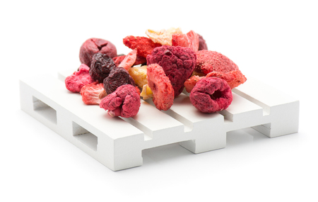 Freeze dried berries mix stack on a pallet isolated on white background