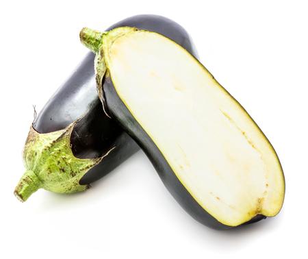 One whole and half eggplant (aubergine), longitudinal section, isolated on white background