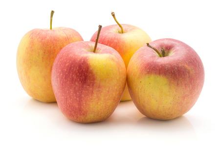 白い背景に分離された4つのリンゴ(エベリーナ品種)