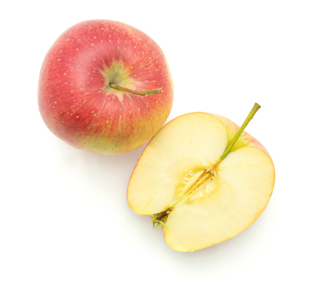 Apple (Evelina variety) isolated on white background top view one whole and one cross section half