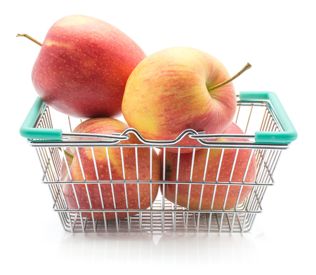 Apples (Evelina variety) in a shopping basket isolated on white background