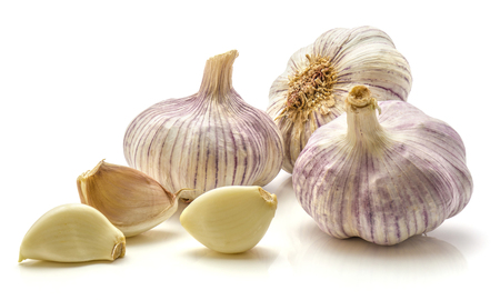 Garlic isolated on white background three whole bulbs and cloves  Stock Photo