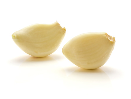 Two peeled garlic cloves isolated on white background  Stock Photo