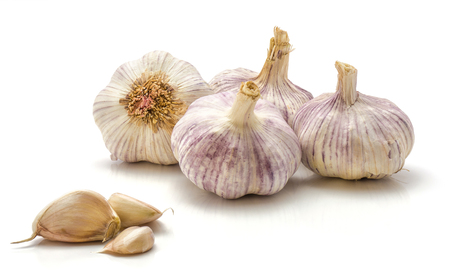 Four garlic bulbs and separated cloves isolated on white background