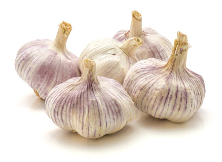 Group of five whole garlic bulbs isolated on white background