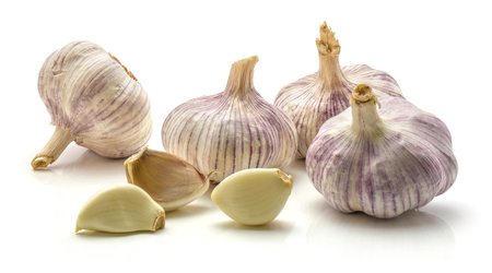 Four whole garlic bulbs and three separated cloves isolated on white background  Stock Photo