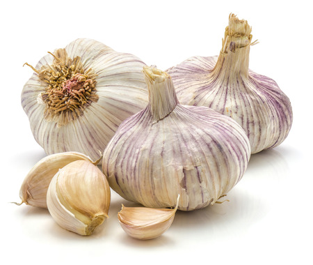 Three garlic bulbs and cloves isolated on white background