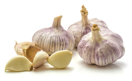 Three whole garlic bulbs and separated cloves isolated on white background