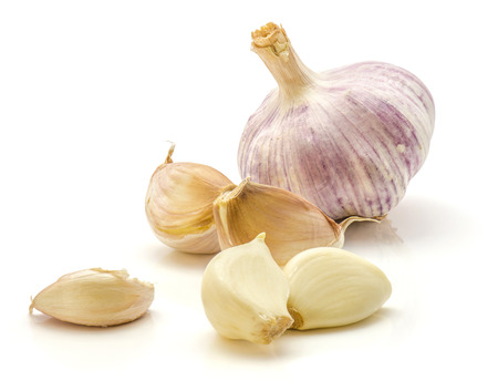 One whole garlic bulb and separated cloves isolated on white background