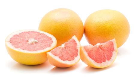 Red grapefruit isolated on white background two whole one half and two slices