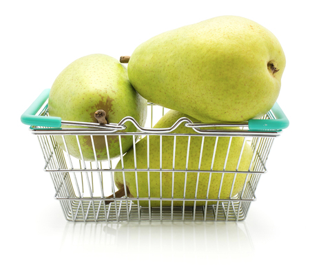 Green pears in a shopping basket isolated on white background three whole
