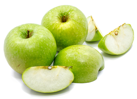 Granny Smith apples, two whole, sliced and one half, isolated on white background  Stock Photo