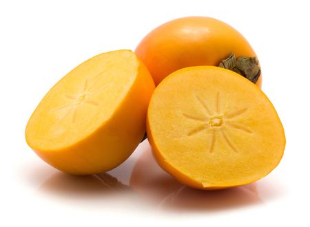Persimmon Kaki isolated on white background one whole two halves cross section