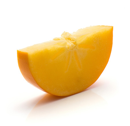 One halved persimmon Kaki slice isolated on white background