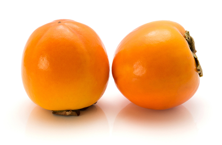 Two persimmon Sharon isolated on white background