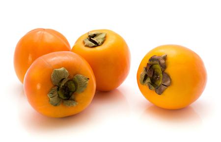 Persimmon Kaki isolated on white background four whole orange  Stock Photo