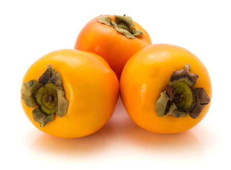 Three persimmon Kaki isolated on white background whole  Stock Photo
