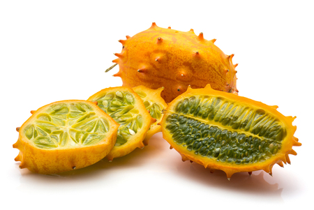 Sliced kiwano isolated on white background one whole one cross section three slices
