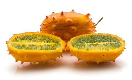 Sliced kiwano isolated on white background one whole one cut in half