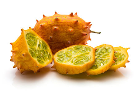 Sliced kiwano isolated on white background one whole one half and three slices