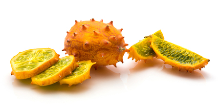 Sliced kiwano isolated on white background one whole two quarters three slices