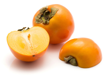 Persimmon Kaki isolated on white background one whole one cut in half