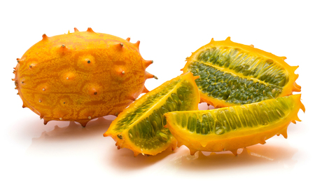 Kiwano isolated on white background one whole one half and two quarters  Stock Photo