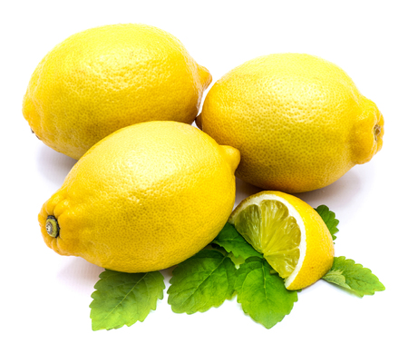 Group of whole yellow lemons, half and slice with fresh lemon balm leaves isolated on white background