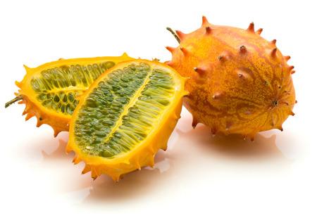 Kiwano isolated on white background one whole orange and three sliced halves with green flesh