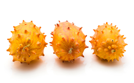 Kiwano isolated on white background three in row