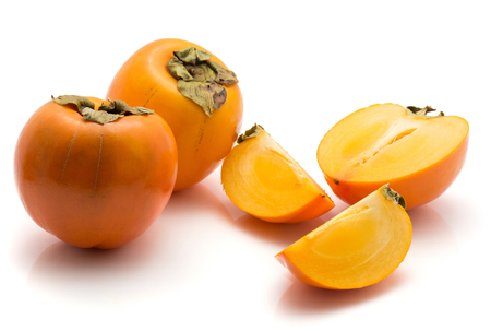 Sliced persimmon Kaki isolated on white background two whole one half two slices  Stock Photo